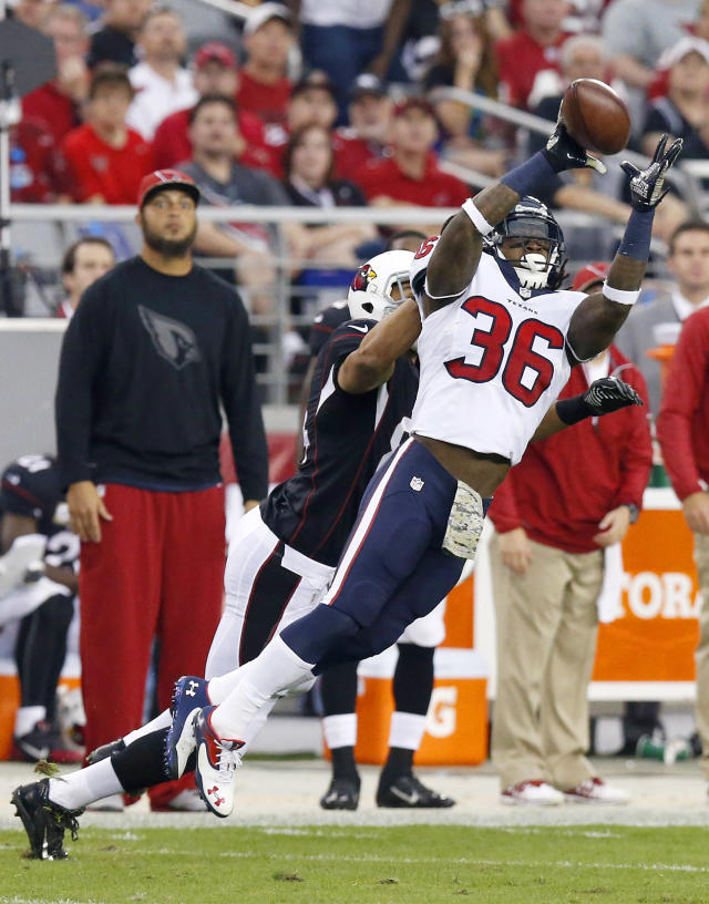Houston Texans' D.J. Swearinger (36) intercepts a pass intended for Arizona Cardinals' Rob Housler during the first half of an NFL football game on Sunday, Nov. 10, 2013, in Glendale, Ariz. (AP Photo/Ross D. Franklin)