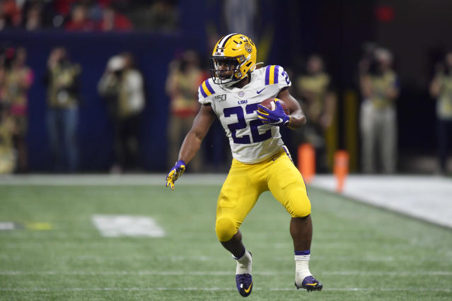 LSU running back Clyde Edwards-Helaire (22) runs against Georgia during the second half of the Southeastern Conference championship NCAA college football game, Saturday, Dec. 7, 2019, in Atlanta. (AP Photo/Mike Stewart)