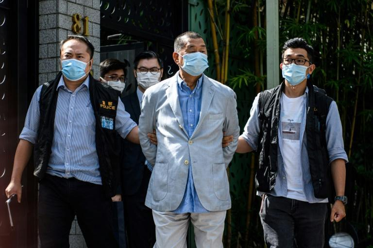 Hong Kong police have arrested pro-democracy media tycoon Jimmy Lai on charges including a violation of China's new security law