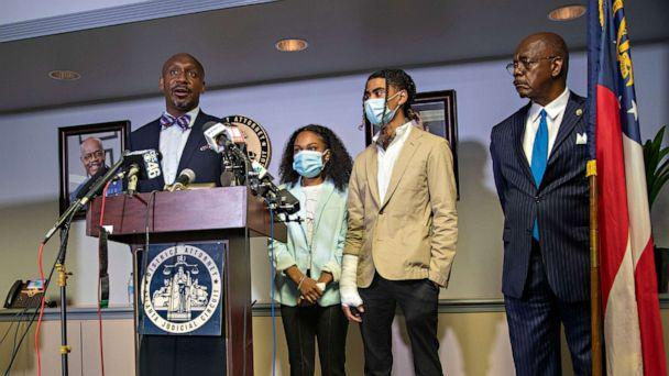 PHOTO: Attorney Mawuli Davis, left, speaks on behalf of Taniyah Pilgrim, center, and Messiah Young, right, during a press conference by the Fulton County District Attorney's Office in Atlanta, June 2, 2020. (Alyssa Pointer/AP)