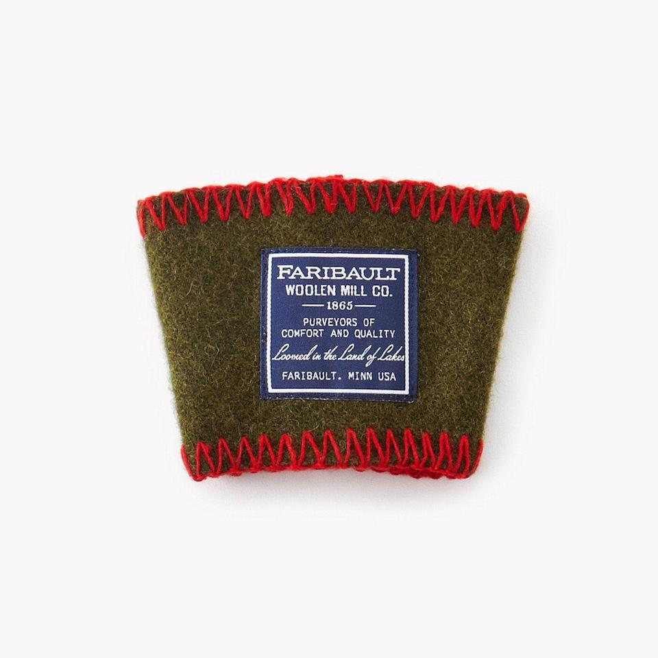 """<p>faribaultmill.com</p><p><strong>$15.00</strong></p><p><a href=""""https://go.redirectingat.com?id=74968X1596630&url=https%3A%2F%2Fwww.faribaultmill.com%2Fproducts%2Fwool-coffee-cup-sleeve&sref=https%3A%2F%2Fwww.countryliving.com%2Fshopping%2Fgifts%2Fg2190%2Fstocking-stuffers%2F"""" rel=""""nofollow noopener"""" target=""""_blank"""" data-ylk=""""slk:Shop Now"""" class=""""link rapid-noclick-resp"""">Shop Now</a></p><p>This robust coffee sleeve is made of blanket remnants from an iconic American mill in Minnesota.</p>"""