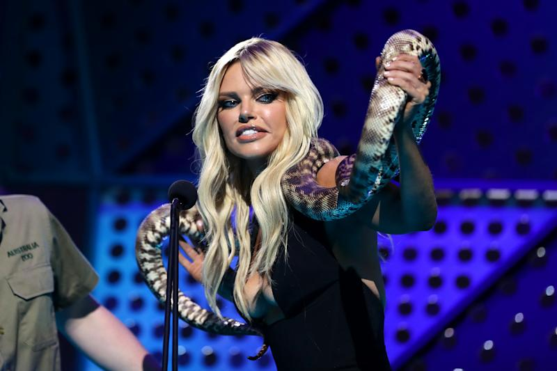 Sophie Monk holds a python on stage during the 33rd Annual ARIA Awards 2019 at The Star on November 27, 2019 in Sydney, Australia.