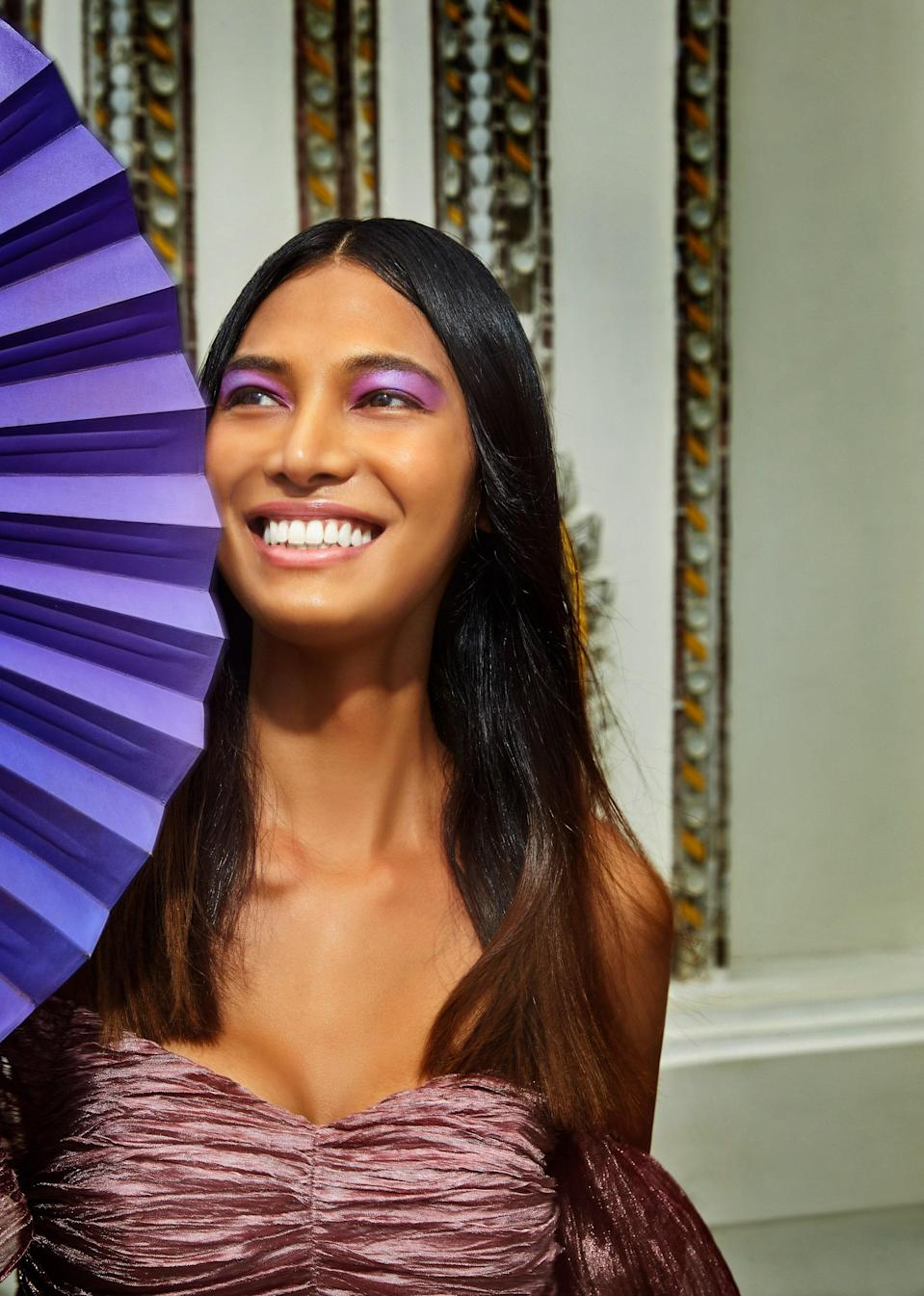 """""""I used to buy all kinds of whitening skin-care products, but now I realize that this is my skin and I should be more proud of myself. I am perfect,"""" says Kulchaya. Barose created her lotus-inspired shadow using two purples (Make Up For Ever Artist Color Eyeshadows in Lavender and Orchid) to mimic a flower petal. Milin dress."""