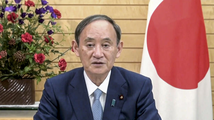 In this image taken from video provided by UN Web TV, Suga Yoshihide, Prime Minister of Japan, remotely addresses the 76th session of the United Nations General Assembly in a pre-recorded message, Friday Sept. 24, 2021, at UN headquarters. (UN Web TV via AP)