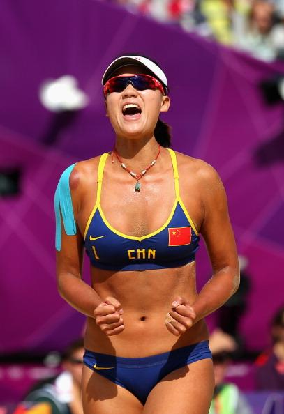 LONDON, ENGLAND - JULY 30:  Chen Xue of China celebrates during their Women's Beach Volleyball Preliminary match between China and Switzerland on Day 3 of the London 2012 Olympic Games at Horse Guards Parade on July 30, 2012 in London, England.  (Photo by Ryan Pierse/Getty Images)