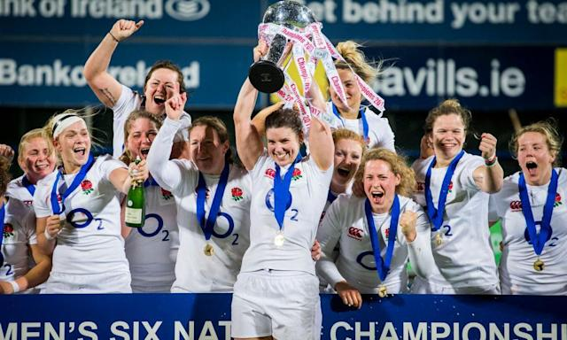 "<span class=""element-image__caption"">The England captain, Sarah Hunter, lifts the Six Nations trophy as she celebrates with her-team mates after defeating Ireland 34-7 at Donnybrook Stadium, Dublin.</span> <span class=""element-image__credit"">Photograph: Liam McBurney/PA</span>"
