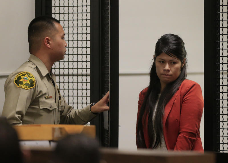 Vanesa Zavala arrives for a preliminary hearing at the West Justice Center in Westminster, California February 10, 2014. Zavala and Candace Marie Brito are facing charges in the beating death of Kim Pham in front of a Santa Ana nightclub. (AP Photo/Los Angeles Times, Mark Boster, Pool)