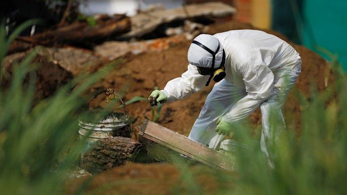 Forensic teams working to exhume the bodies