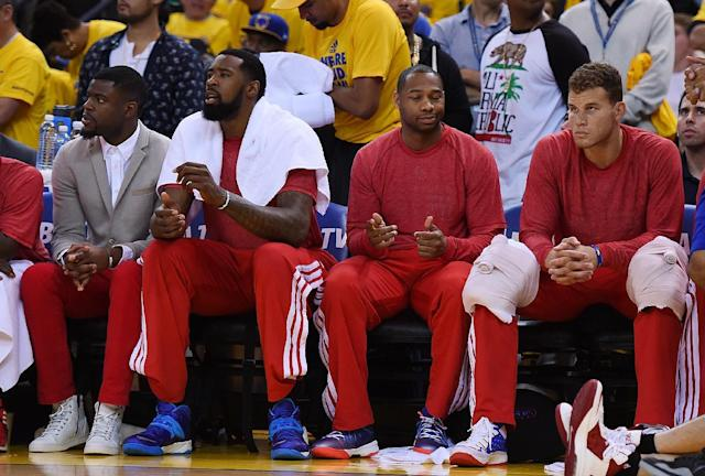 OAKLAND, CA - APRIL 27: Los Angeles Clippers players sit on the bench wearing their warm-up tops inside out against the Golden State Warriors in Game Four of the Western Conference Quarterfinals during the 2014 NBA Playoffs at ORACLE Arena on April 27, 2014 in Oakland, California. The players wore theirs warm up this way in protest of owner Donald Sterling's racially insensitive remarks. (Photo by Thearon W. Henderson/Getty Images)