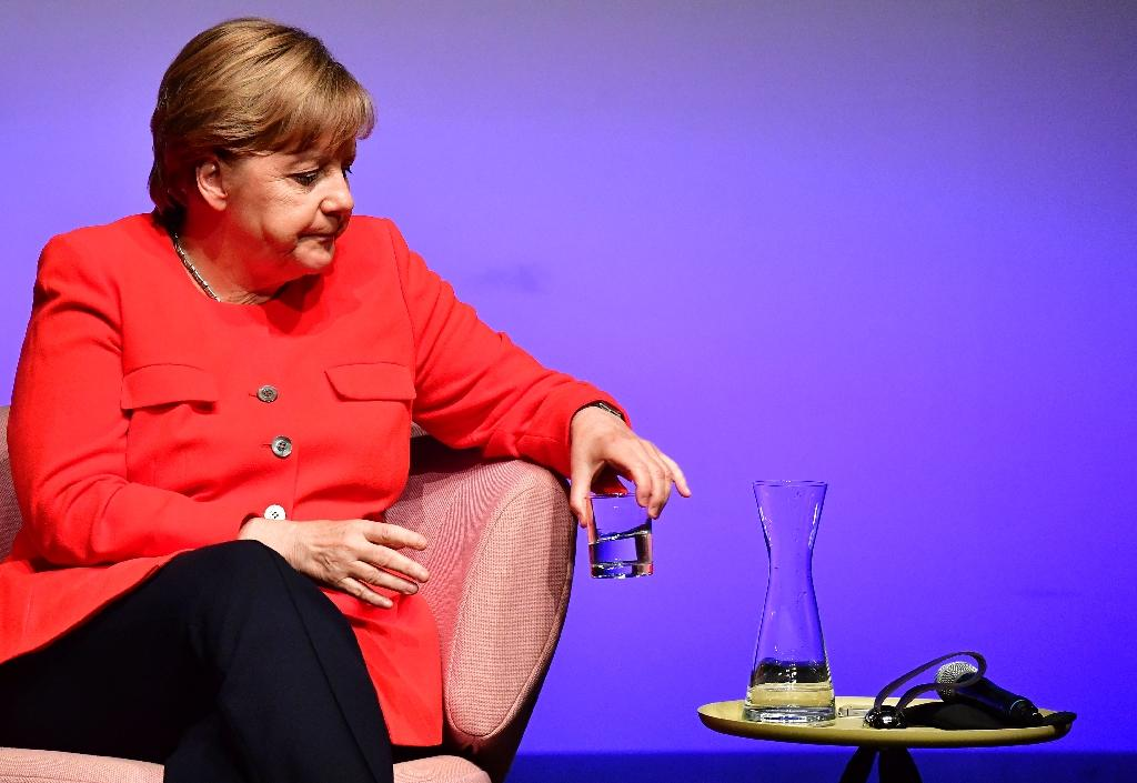 German Chancellor Angela Merkel, who had repeatedly voiced her opposition to gay marriage, said that lawmakers could vote according to their conscience, and not toe the party line (AFP Photo/TOBIAS SCHWARZ)
