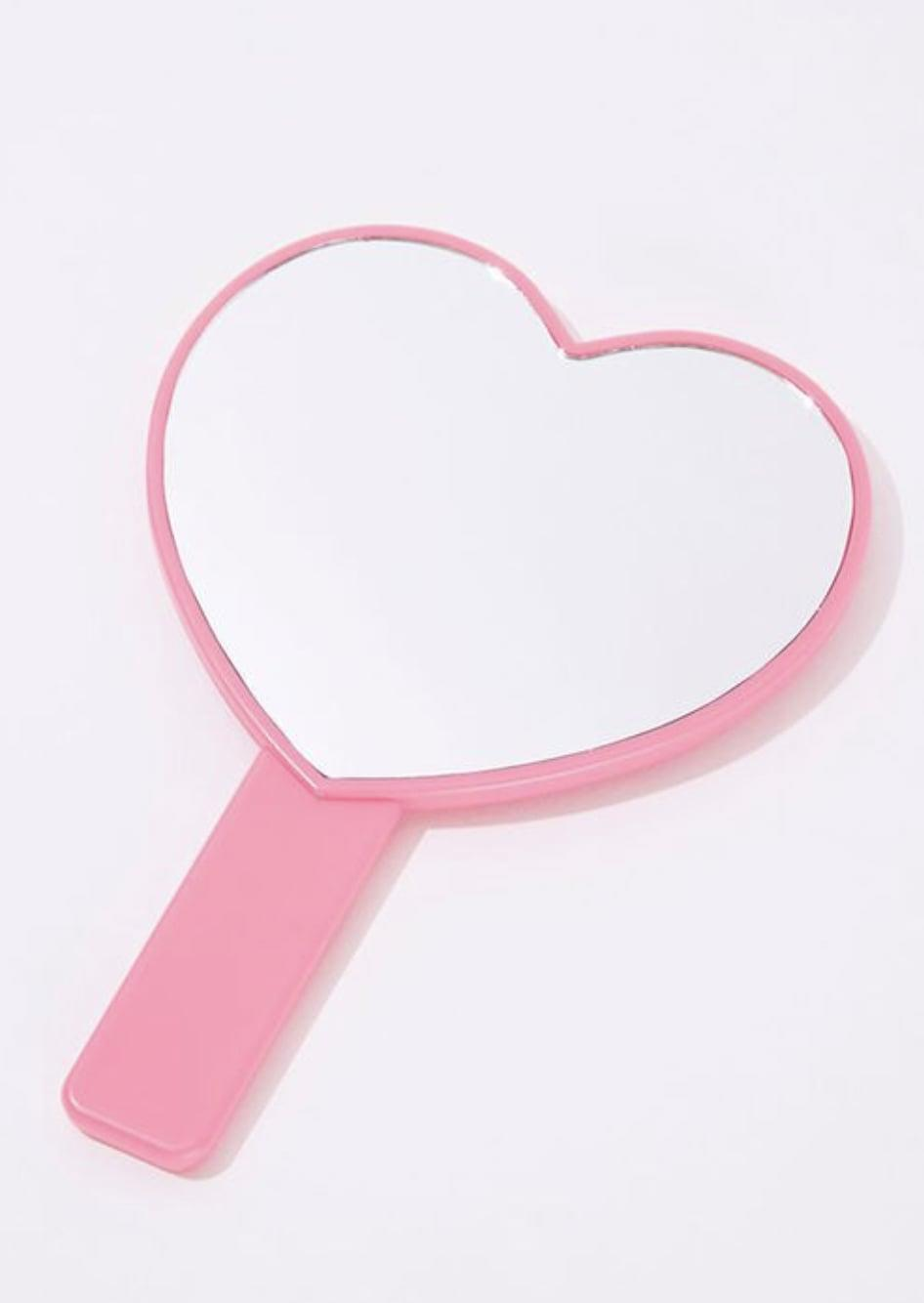 <p>Add this <span>Forever 21 Heart-Shaped Mirror</span> ($2, originally $5) to a vanity setup.</p>