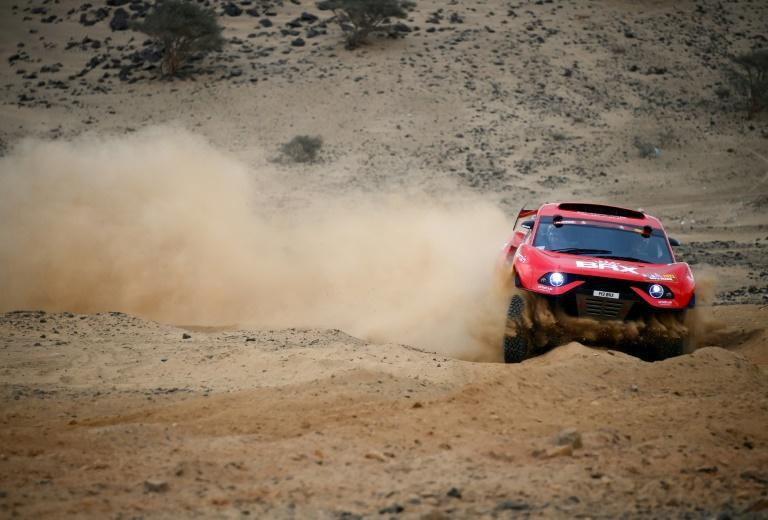 Dust busters: Sebastien Loeb and co-driver Daniel Elena test out their car ahead of the 2021 Dakar Rally