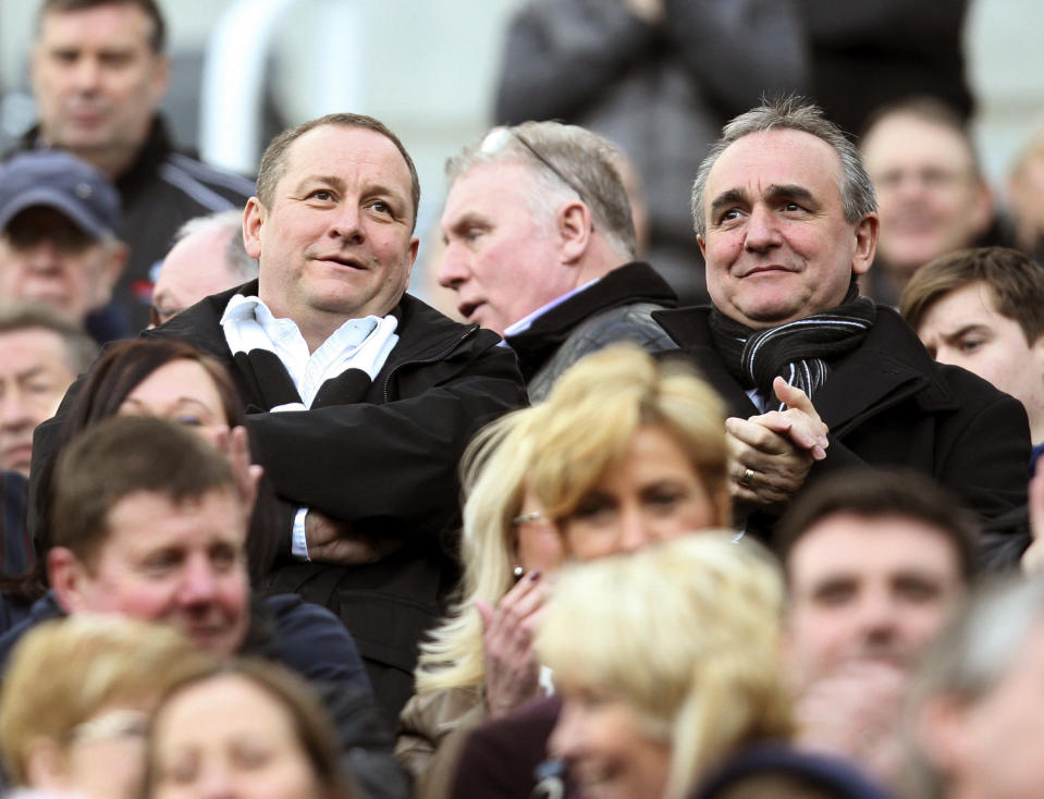 FILE - In this Saturday, Feb. 25, 2012 file photo, Newcastle United's owner Mike Ashley, left, and Chief Executive Derek Llambias, right, in the stands ahead of the English Premier League soccer match between Newcastle United and Wolverhampton Wanderers at the Sports Direct Arena, in Newcastle, England. English Premier League club Newcastle was taken over by Saudi Arabia's sovereign wealth fund on Thursday, Oct. 7, 2021 after a protracted takeover. The takeover by the Saudi Public Investment Fund initially collapsed last year over concerns about how much control the kingdom's leadership would have in the running of Newcastle amid concerns about Saudi human rights abuses and the pirating of sports rights. (AP Photo/Scott Heppell, File)