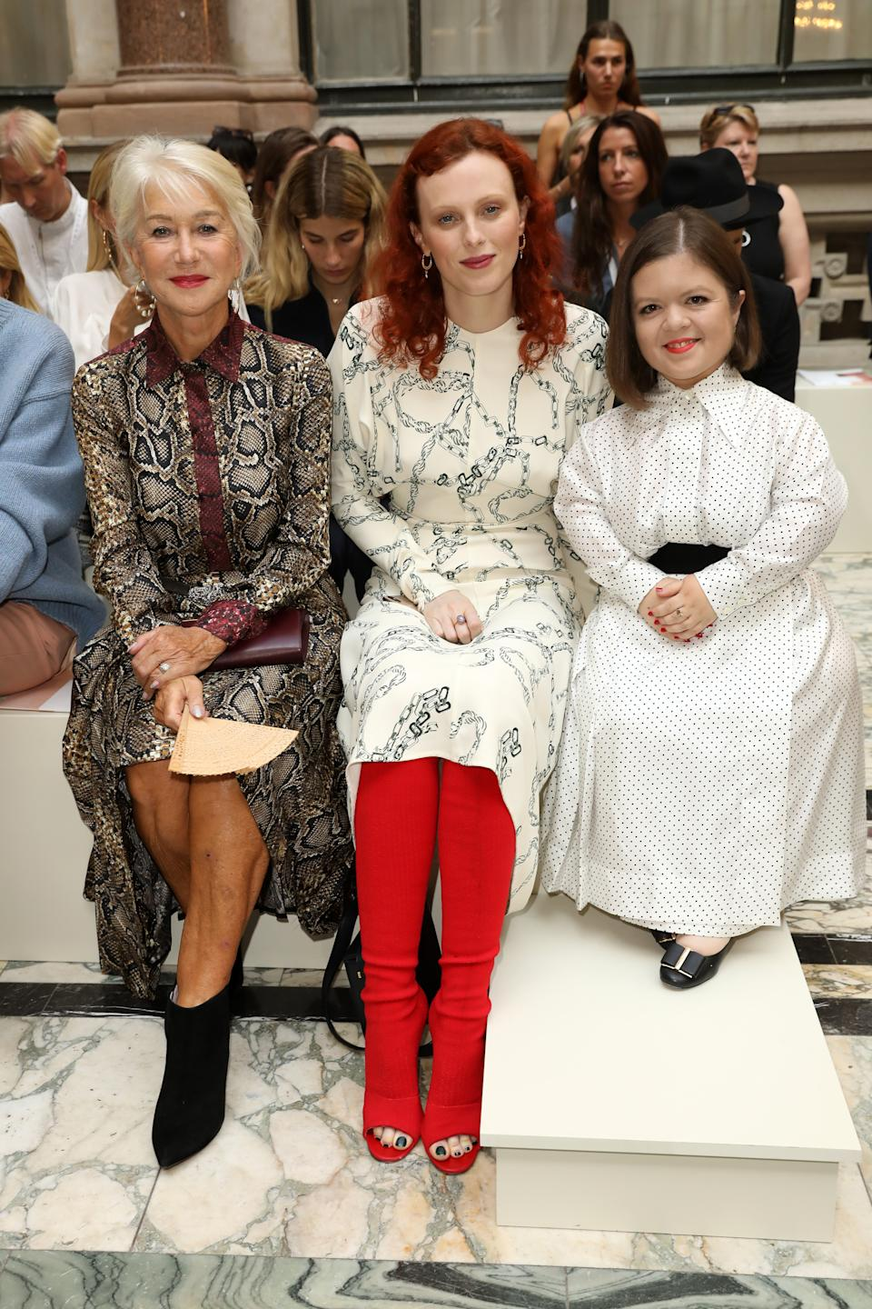Helen Mirren, Karen Elson and Sinead Burke pose for a photo on the front row [Photo: Getty]