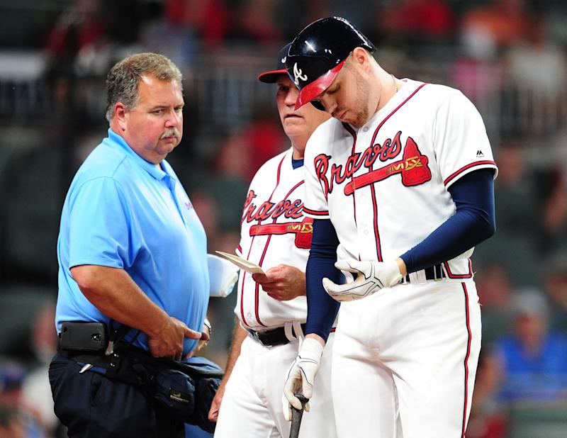 Freddie Freeman checks his hand after being hit Wednesday night. (Getty Images)