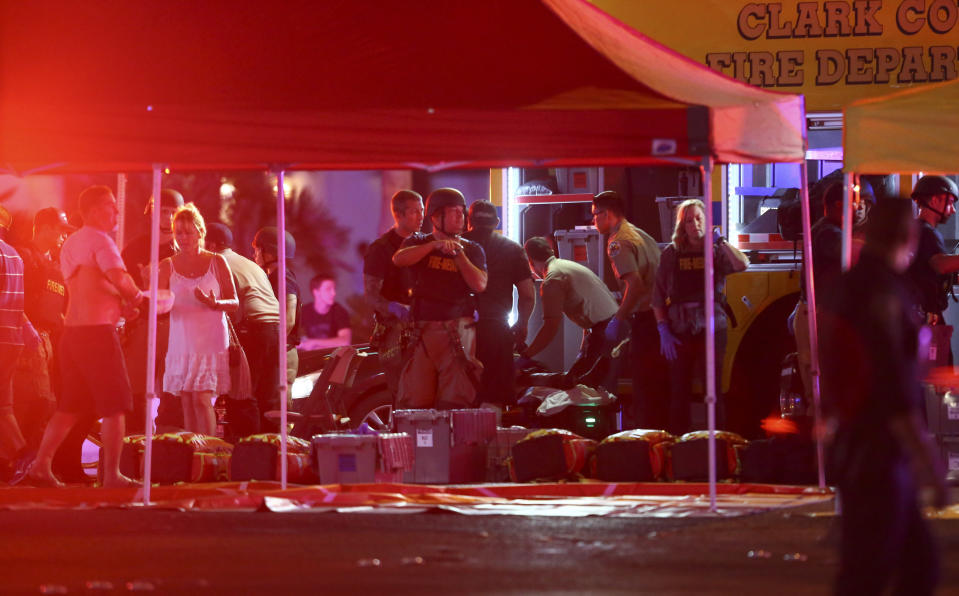 <p>Medics treat the wounded as Las Vegas police respond to an active shooter. (AP) </p>