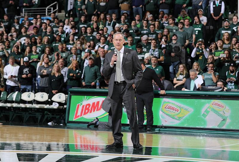 EAST LANSING, MI - FEBRUARY 04: Head coach Mark Dantonio of the Michigan State Spartans address the crowd during halftime of a college basketball game between the Michigan State Spartans and Penn State Nittany Lions at the Breslin Center on February 4, 2020 in East Lansing, Michigan. (Photo by Rey Del Rio/Getty Images)