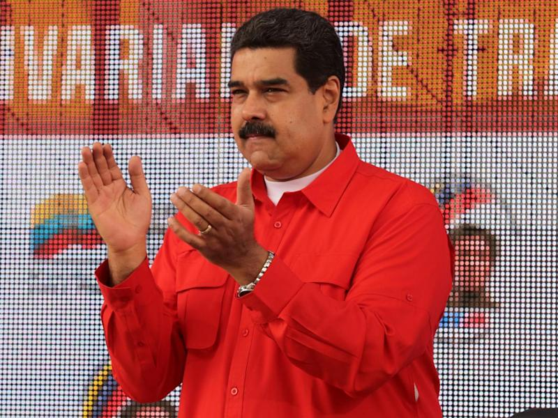 Venezuela's President Nicolas Maduro applauds as he attends a pro-government rally with workers in Caracas on 18 March 2017 (Reuters)