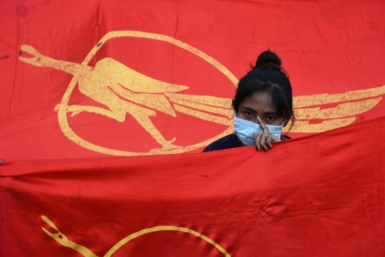 Many protestors waved the signature red flags of Suu Kyi's National League for Democracy (NLD) party