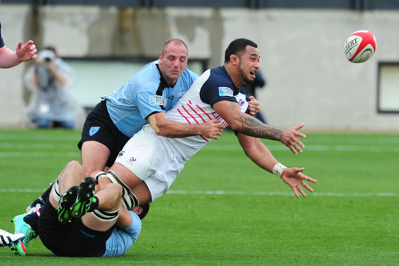 KENNESAW, GA - MARCH 29: Samu Manoa #5 of the USA Eagles passes against Alejo Corral #1 of Uruguay during the opening qualifying match of the 2015 IRB Rugby World Cup at Fifth Third Bank Stadium on March 29, 2014 in Kennesaw, Georgia. (Photo by Scott Cunningham/Getty Images)