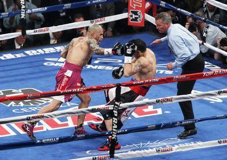 Jun 7, 2014; New York, NY, USA; Sergio Martinez takes a punch from Miguel Cotto in the first round of WBC World Middleweight fight at Madison Square Garden. Cotto by TKO. Mandatory Credit: Noah K. Murray-USA TODAY Sports