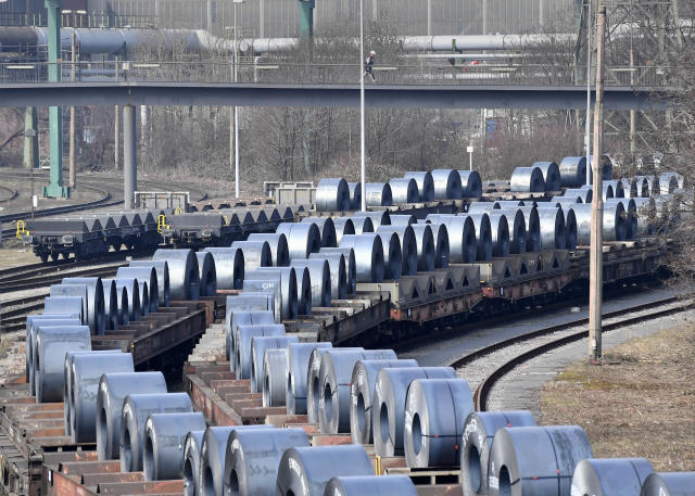 Steel coils sit on wagons when leaving the ThyssenKrupp steel factory in Duisburg, Germany. (AP Photo/Martin Meissner)