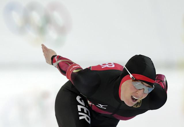 Claudia Pechstein of Germany competes in the women's 5,000-meter speedskating race at the Adler Arena Skating Center during the 2014 Winter Olympics in Sochi, Russia, Wednesday, Feb. 19, 2014. (AP Photo/Matt Dunham)