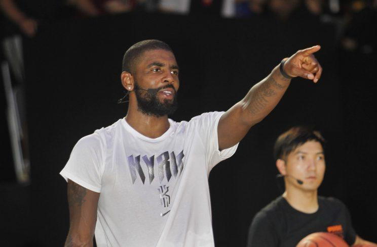 Kyrie Irving gives instructions Saturday at a basketball clinic in Taipei, Taiwan. (AP)