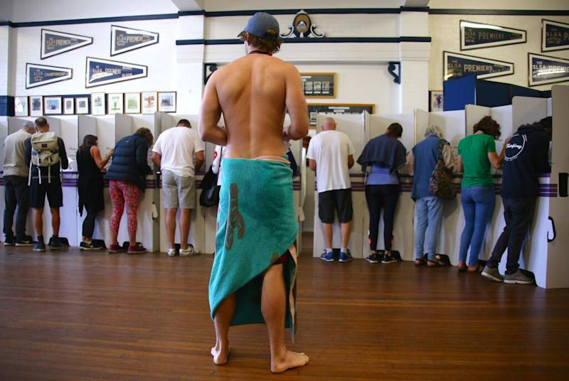 At the Bondi surf club a voter dressed in a towel waits in line to cast his ballot. Source: Getty