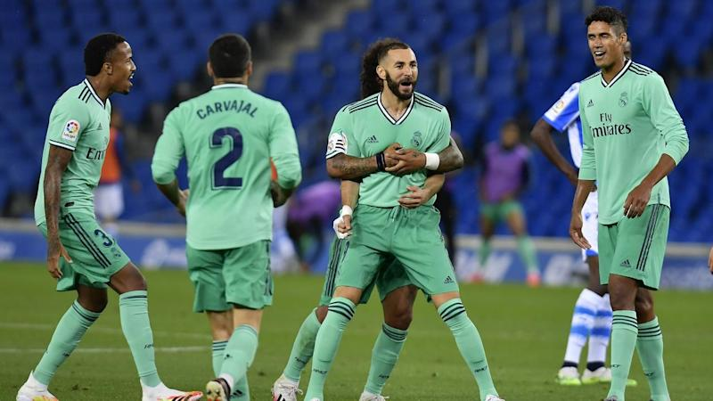 Karim Benzema (c) celebrates scoring Real Madrid's second goal in the 2-1 win at Real Sociedad