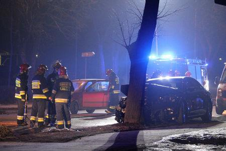 Firefighter officers inspect a site and Polish Prime Minister's Beata Szydlo's car after an accident in Oswiecim