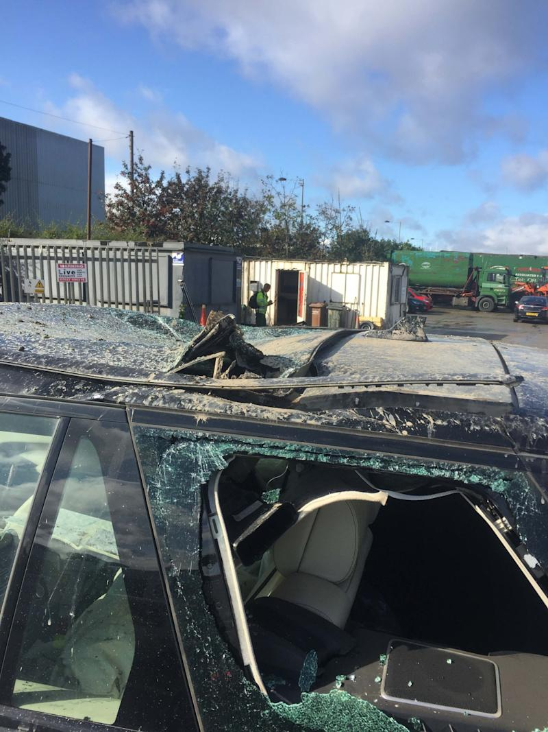 Damage to Thomas Crompton's Range Rover caused by an employee who went rogue with a 360 digger - 2nd October 2019 . See SWNS story SWLEdigger. This is the shocking moment a disgruntled worker in a digger went on the rampage at a demolition site - smashing his boss' £100,000 Range Rover and a truck. In a series of CCTV and mobile phone footage, the driver can be seen crashing into a black top-of-the-range 4x4 before wheeling off to pummel a second vehicle on Saturday morning (28 Sept). Staff at Thomas Crompton Demolition, Bradford, West Yorks., where then alerted to what was going on and rushed out to the vehicle to pull the man from the cab. Owner Thomas Crompton today (WED) told how they feared the employee was heading towards their fleet of 60 vehicles - valued at £6m pounds.