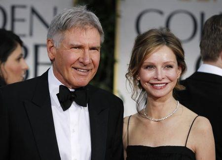 Actors Harrison Ford and Calista Flockhart arrive at the 69th annual Golden Globe Awards in Beverly Hills