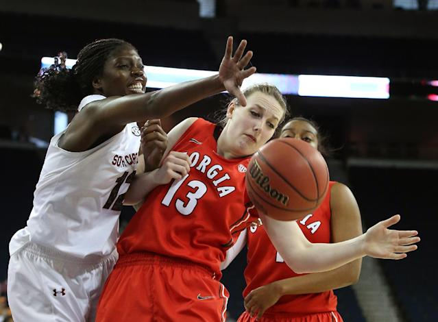 South Carolina forward Wilka Montout (12) and Georgia forward Merritt Hempe (13) battle for a rebound in the first half of a quarterfinal women's Southeastern Conference tournament NCAA college basketball game Friday, March 7, 2014, in Duluth, Ga. (AP Photo/Jason Getz)