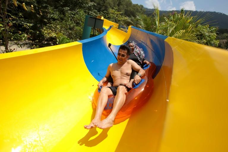It takes four minutes to slide down the chute, which passes through a rainforest inhabited by exotic creatures (AFP Photo/SADIQ ASYRAF)