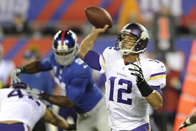 FILE - In this Oct. 21, 2013 file photo, Minnesota Vikings quarterback Josh Freeman (12) throws a pass during the first half of an NFL football game against the New York Giants in East Rutherford, N.J. (AP Photo/Bill Kostroun, File)