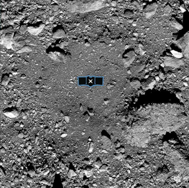 PHOTO: This undated photo shows the OSIRIS-REx primary sample site, Nightingale. The center of the site is marked with an X, and a silhouette of the spacecraft is added for scale. (University of Arizona/Goddard/NASA)