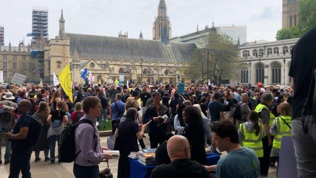 People take part in an anti-vaccine protest in Parliament Square