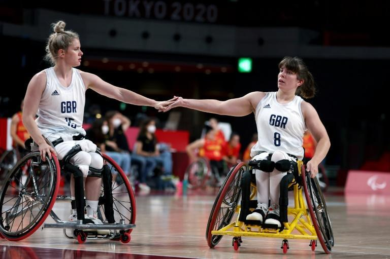 British wheelchair basketball players Robyn Love (left) and Laurie Williams think the Tokyo Paralympics can help change perceptions of LGBTQ people with disabilities (AFP/Behrouz MEHRI)