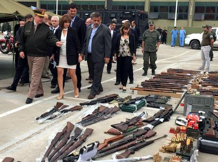 FILE PHOTO: Argentina's Security Minister Patricia Bullrich looks at weapons and ammunition that were seized by Argentine authorities in a container coming from the United States, at the Argentine gendarmerie headquarters in Buenos Aires, Argentina November 5, 2018. REUTERS/Miguel Lo Bianco/File Photo