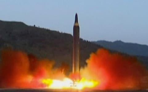 The launch of a Hwasong-12 missile at an undisclosed location in North Korea in May - Credit: AP
