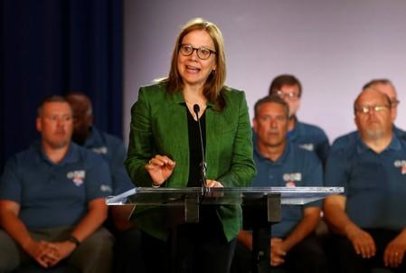 General Motors Chairman and CEO Mary Barra makes a statement as members of the United Auto Workers bargaining committee listen at the start of contract talks between the union and automaker in Detroit