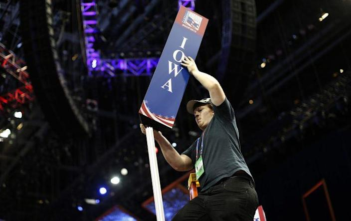 Scott Kiss installs the Iowa state delegation sign on the floor of the Republican National Convention in Tampa, Fla., August 26, 2012. This year's convention starts on August 28. (Photo: Mike Segar/Reuters)
