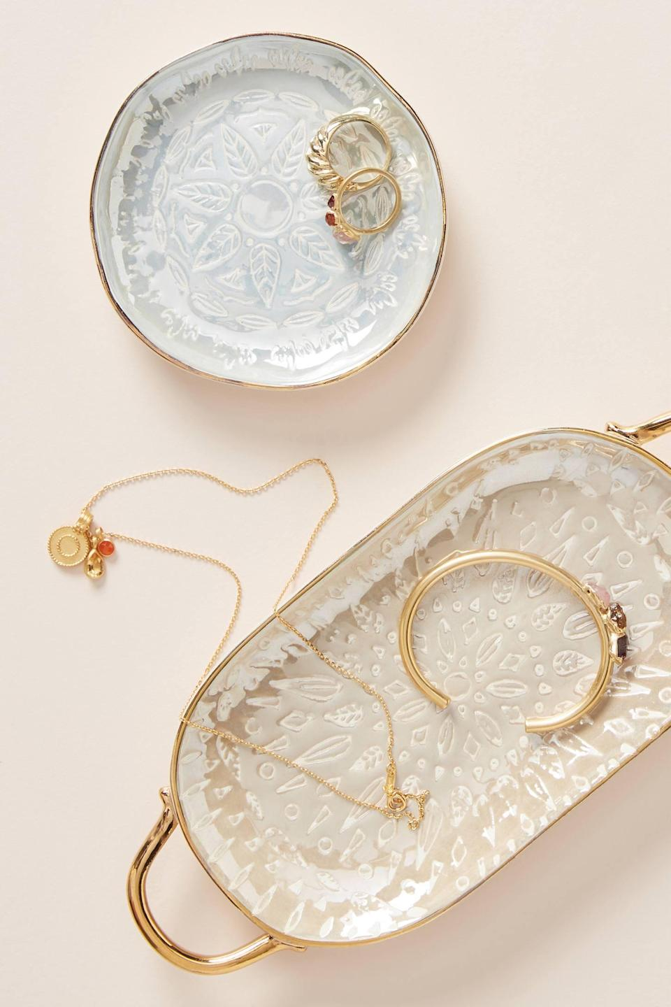 "<p><strong>Anthropologie</strong></p><p>anthropologie.com</p><p><strong>Out of Stock</strong></p><p><a href=""https://www.anthropologie.com/shop/lucia-trinket-dish"" rel=""nofollow noopener"" target=""_blank"" data-ylk=""slk:SHOP NOW"" class=""link rapid-noclick-resp"">SHOP NOW</a></p><p>Now she can keep all of the <a href=""https://www.womansday.com/style/fashion/a54387/mistakes-ruining-your-jewelry/"" rel=""nofollow noopener"" target=""_blank"" data-ylk=""slk:fine jewelry"" class=""link rapid-noclick-resp"">fine jewelry</a> you've given her over the years on these stylish hand-painted dishes.</p>"
