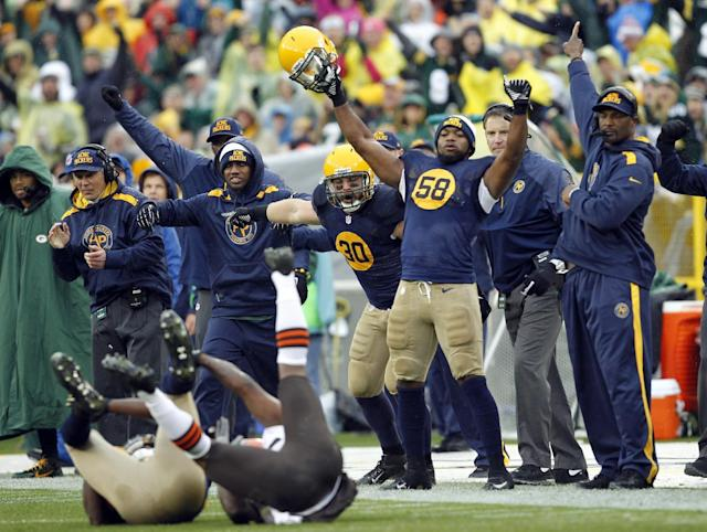 The Green Bay Packers bench celebrates after cornerback Davon House intercepted a pass during the first half of an NFL football game against the Cleveland Browns Sunday, Oct. 20, 2013, in Green Bay, Wis. (AP Photo/Mike Roemer)