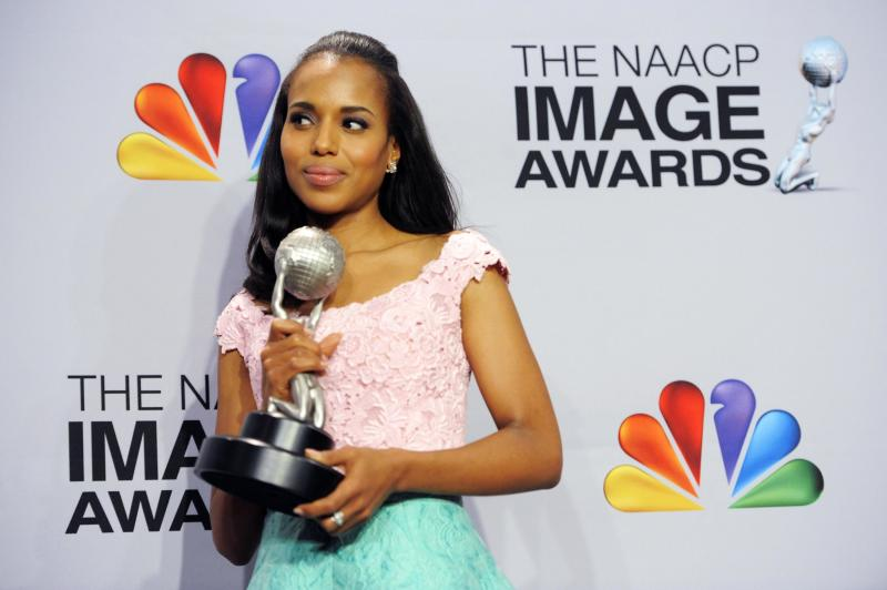 """Kerry Washington poses backstage with the award for outstanding actress in a drama series for """"Scandal"""" at the 44th Annual NAACP Image Awards at the Shrine Auditorium in Los Angeles on Friday, Feb. 1, 2013. (Photo by Chris Pizzello/Invision/AP)"""