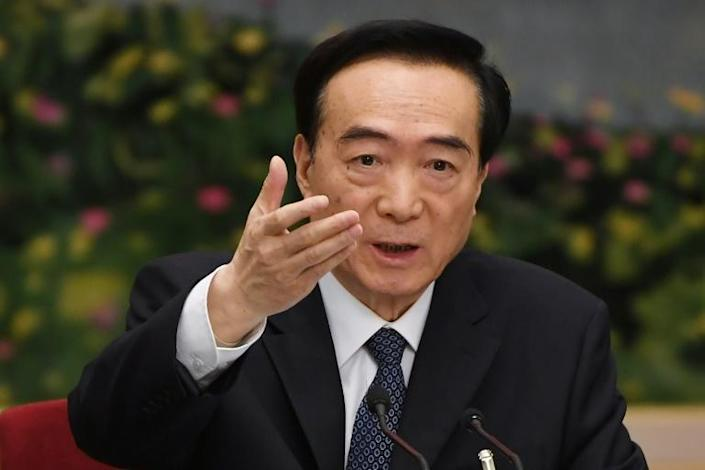 Xinjiang's Communist Party chief Chen Quanguo, seen here in March 2019, has been hit by US sanctions as Washington steps up pressure over treatment of the Uighur community (AFP Photo/GREG BAKER)