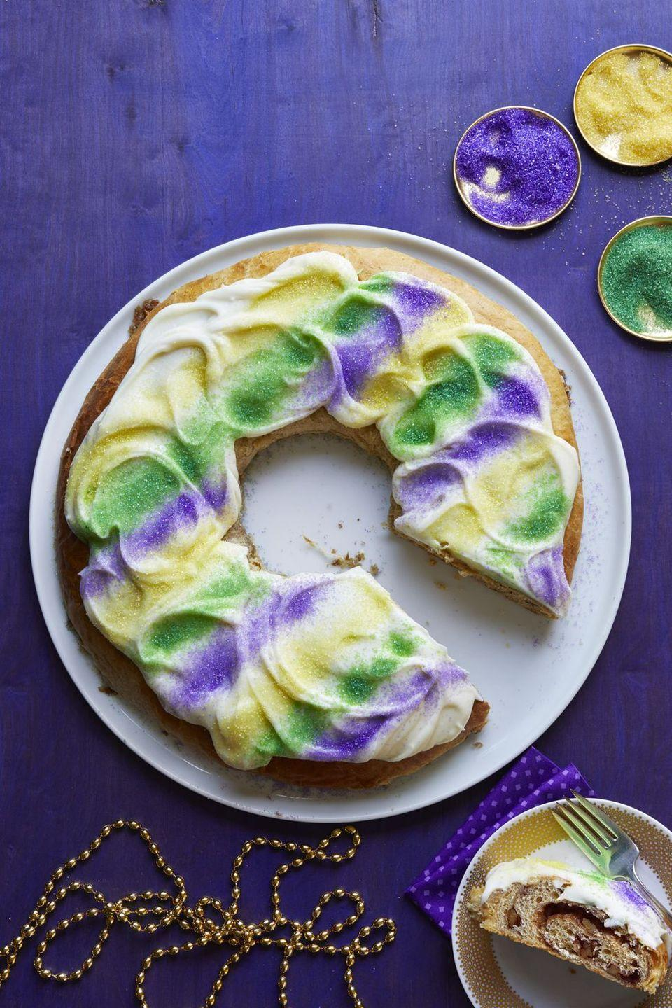 """<p>During Mardi Gras season in New Orleans, <a href=""""http://www.womansday.com/food-recipes/food-drinks/recipes/a61040/king-cake-recipe/"""" rel=""""nofollow noopener"""" target=""""_blank"""" data-ylk=""""slk:king cakes"""" class=""""link rapid-noclick-resp"""">king cakes</a> are ubiquitous. Each pastry is hiding a tiny plastic baby inside. Tradition holds that if you find the baby inside your <a href=""""https://www.countryliving.com/food-drinks/g745/homemade-cake-recipes-0309/"""" rel=""""nofollow noopener"""" target=""""_blank"""" data-ylk=""""slk:slice of cake,"""" class=""""link rapid-noclick-resp"""">slice of cake,</a> you'll be bringing king cake to the next gathering. </p>"""
