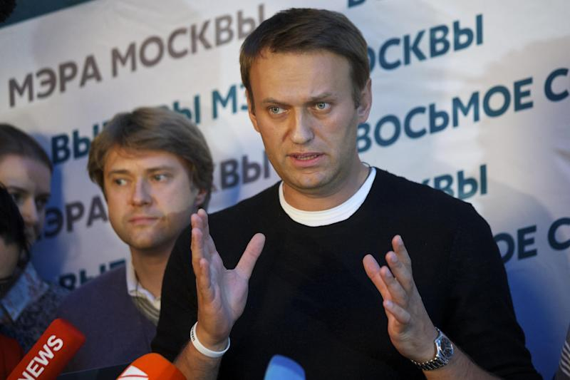 Russian opposition leader Alexei Navalny speaks to the media at his headquarters in Moscow, Russia, Sunday, Sept. 8, 2013.Two exit polls in Moscow's mayoral election are predicting a stronger showing than expected for opposition leader Alexei Navalny. Sunday's mayoral election is a potentially pivotal contest that has energized the small opposition in ways that could pose a risk to the Kremlin in the days and years ahead. (AP Photo/Alexander Zemlianichenko)