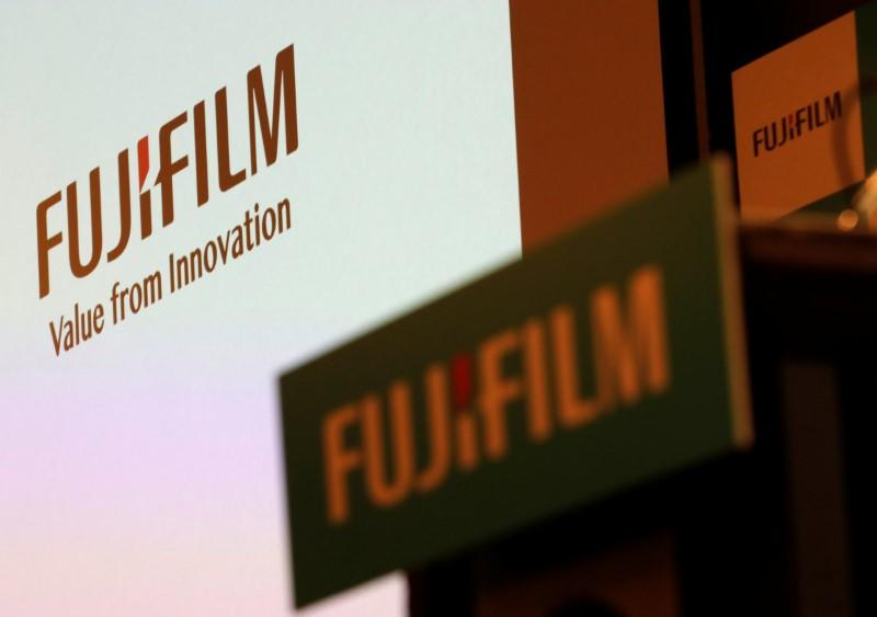 FILE PHOTO: Fujifilm Holdings' logos are pictured ahead of its news conference in Tokyo, Japan January 31, 2018. REUTERS/Kim Kyung-Hoon